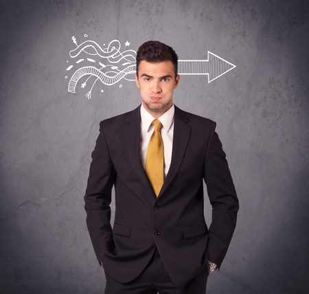 suspicion: An elegant confident  businessman in suit knows the solution to a problem concept with drawn arrow illustration on urban concrete wall concept