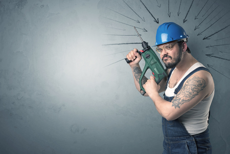 manufacturer: Working man with tools in his hand and arrows above his head. Stock Photo