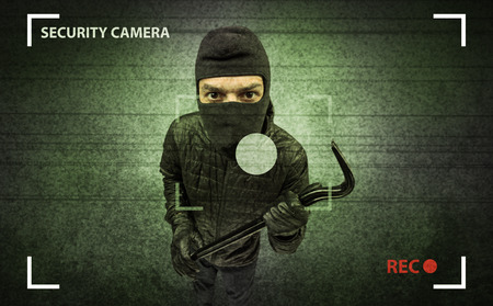 Caught burglar by house camera in action. Stok Fotoğraf