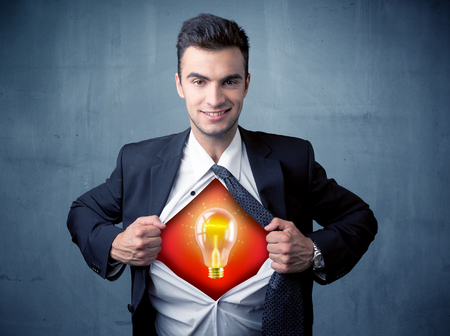super man: Businessman ripping off shirt and idea light bulb appears on his chest concept on backround