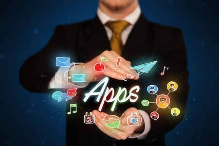 electronic music: Businessman with drawn application icons and symbols in his hands