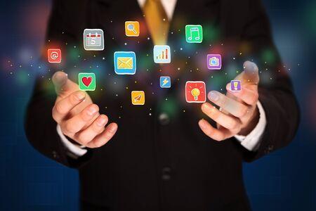 electronic music: Elegant businessman holding colorful mixed media icons