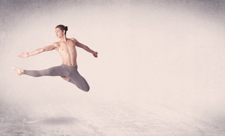 an entertainer: Modern ballet dancer performing art jump with empty copy space background