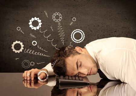 hitting: Falling apart illustration concept with cranks, cog wheels springing from a fed up and tired businessmans head resting on laptop keyboard Stock Photo