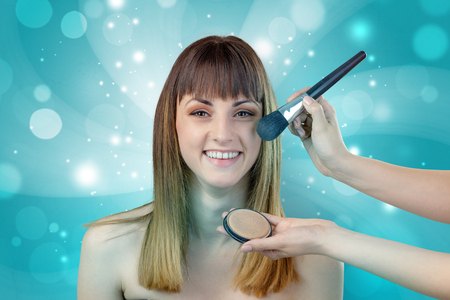 hair stylist: Graceful brunette woman getting ready with shiny turquoise wallpaper Stock Photo