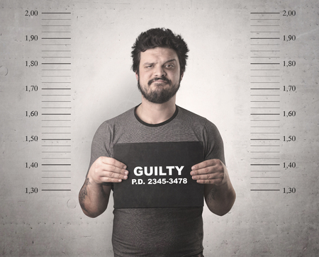 Caught guilty man with ID signs on his hand. Stock Photo