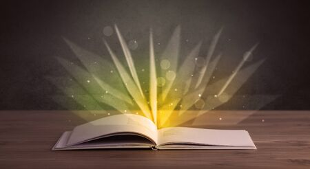 aura: Yellow lights spreading from an open book