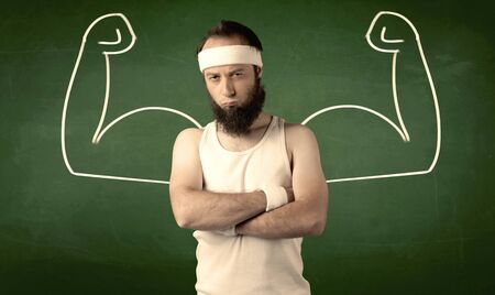 A young man with beard and glasses posing in front of green background, imagining how he would look like with big muscles, illustrated by minimalist white drawing concept. photo