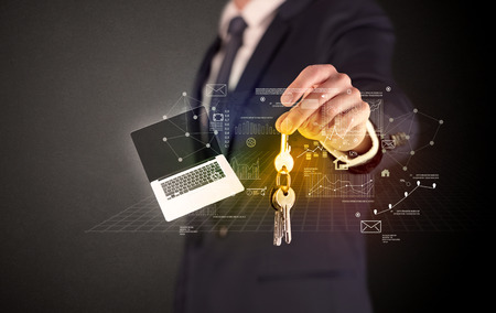 shiny car: Businessman in suit holding keys with statistics, graphs and icons around