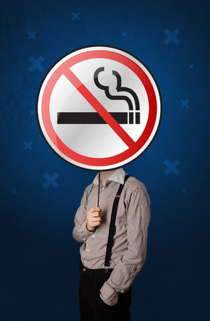 habit: Casual businessman holding round sign with no smoking graphic