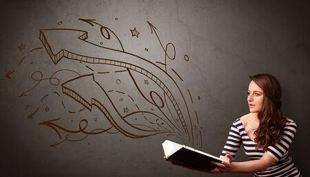 Casual young woman holding book with brown arrows and stars flying out of it photo