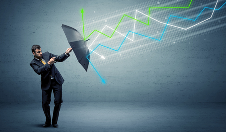 Business person with umbrella and colorful stock market arrows concept Banco de Imagens