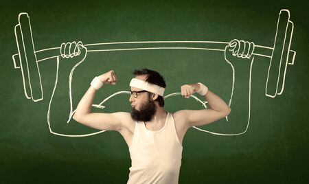 A young man with beard and glasses posing in front of green background, imagining how he would lift weight with big muscles, illustrated by white drawing concept. photo