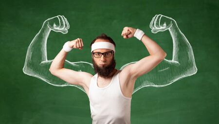 A young male with beard and glasses posing in front of green background, imagining how he would look like with big muscles, illustrated by white drawing concept. photo