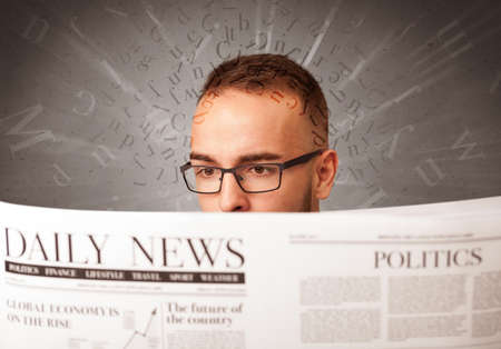 articles: Young smart businessman reading daily newspaper with alphabet letters above his head Stock Photo