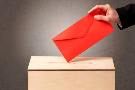 referendum: Ballot box with person casting vote on blank voting slip, grungy background