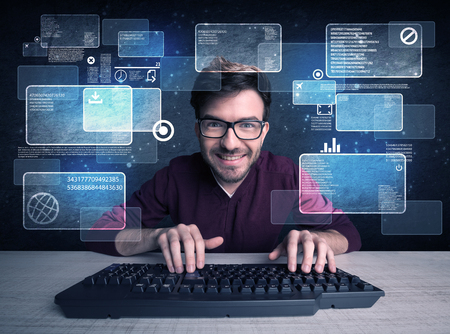 A confident young hacker working hard on solving online password codes concept with a computer keyboard and illustrated digital screen, numbers in the background Фото со стока