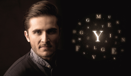 word of mouth: Close-up of handsome businessman with alphabet letters near him. Communication, information, intelligence concept