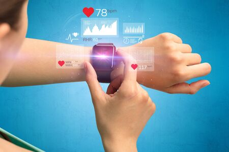 heart monitor: Female hand with smartwatch and health application icons nearby.