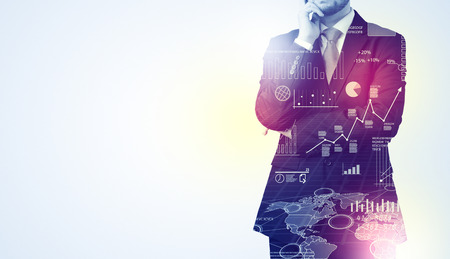 Leader man standing and thinking with graphs, charts, diagrams on the background Stock Photo