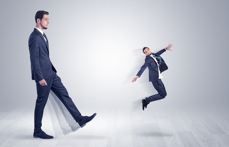 flit: Big man in suit kicking out little himself with simple white wallpaper