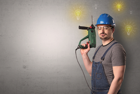 Craftsman with tool and new idea symbol in his hand. Stock Photo