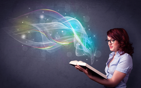 aura energy: Casual young woman holding book with rainbow waves flying out of it