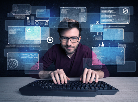 A confident young hacker working hard on solving online password codes concept with a computer keyboard and illustrated digital screen, numbers in the background Stock Photo