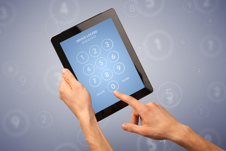 combination: Female fingers touching tablet with locked device requiring passcode