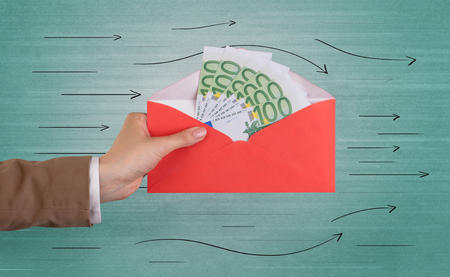 Female hand holding coloured and white envelope with green background and arrows around