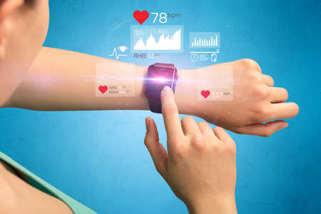 potential: Female hand with smartwatch and health application icons nearby.