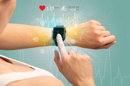 potential: Hand with smartwatch and cycling concept nearby. Stock Photo