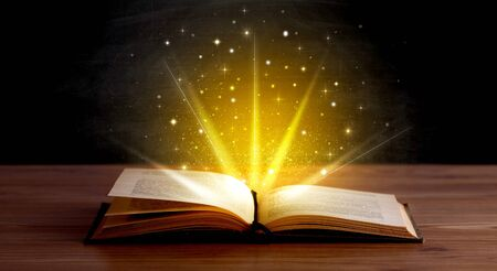 aura energy: Yellow lights and sparkles coming from an open book