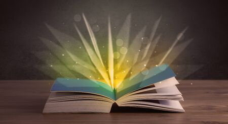 aura energy: Yellow lights spreading from an open book