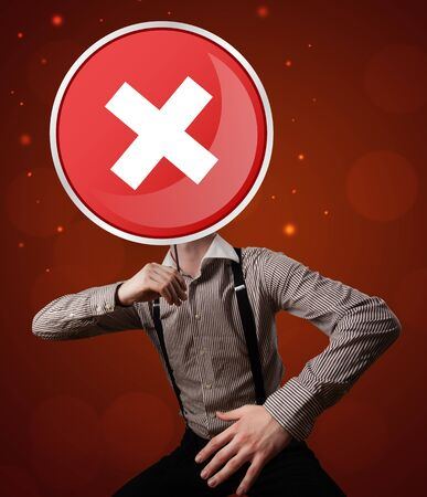 rejection: Casual businessman holding round red sign with a white cross