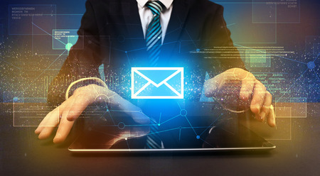 human evolution: Businessman in suit typing with communication, mailing concept around