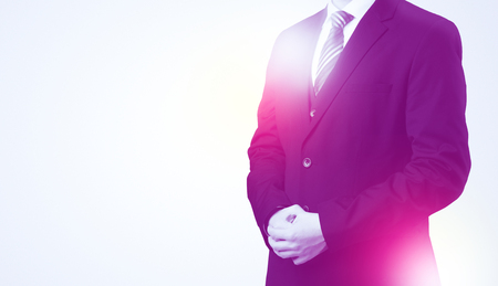 resolving: Young businessman standing and thinking without head