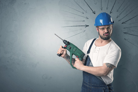 Working man with tools in his hand and arrows above his head. Stock Photo
