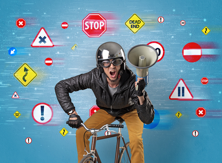 Young guy with stylish outlook and highway code on the background Stock Photo