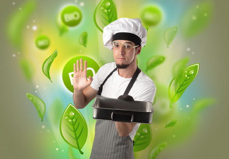 Green bio leaves concept and cook portrait with kitchen tools