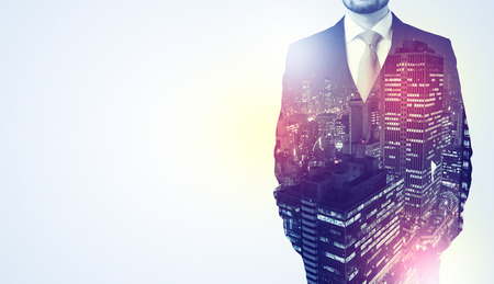 Young businessman standing and thinking with night city background