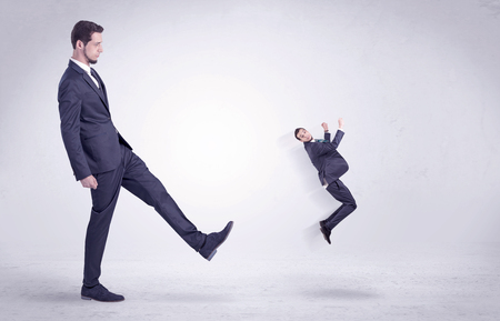 flit: Big man in suit kicking out little himself out with simple white wallpaper