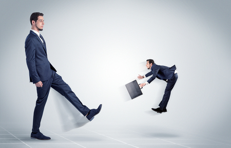 mobbing: Young businessman fired cruel and aggressive by his boss with white background  Stock Photo
