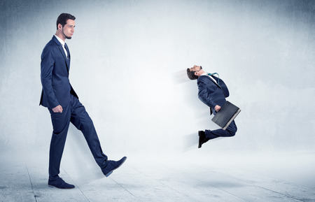 flit: Big businessman kicking small businessman who is flying away with his briefcase on his hand