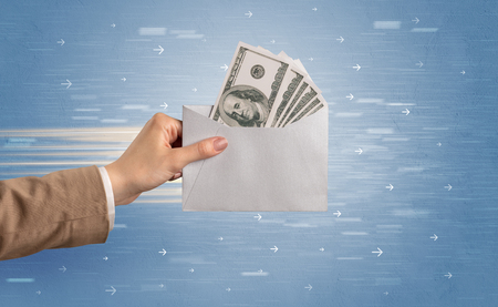 Female hand holding empty and full envelope with blue background and direction concept  Stock Photo