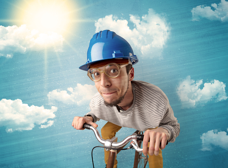 Nerd, crazy stylish rider on the bicycle with sunny weather Stock Photo