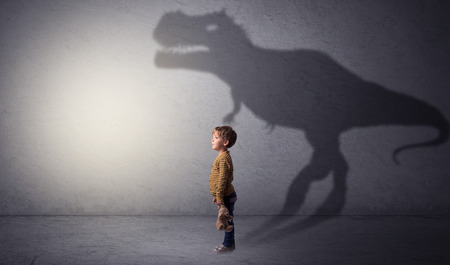I'm dreaming about dinosaurus concept with cute little boy in an empty room