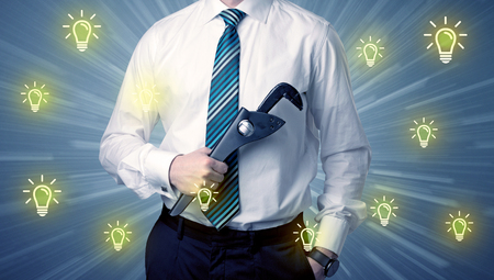 Better-looking businesman holding tool with idea bulbs concep Stockfoto