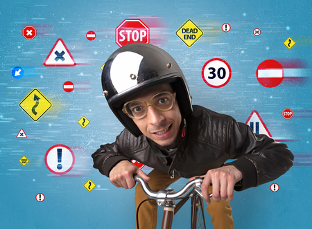 Young guy with stylish outlook and highway code on the background Stock fotó