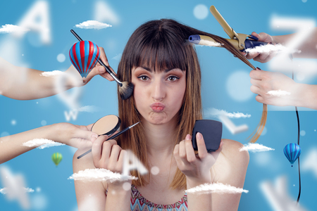 Young brunette woman smiling at hairdresser with clouds and air balloons around  Stock Photo